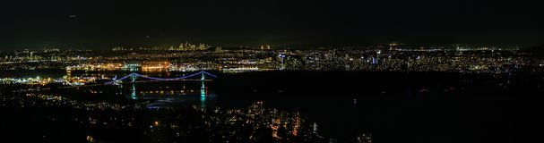 Night top-down scenic view on the large American city. North american city at night from the helicopter with enlighten architecture and reflections on the water Royalty Free Stock Photos