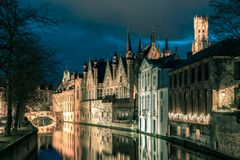 Night tower Belfort and the Green canal in Bruges Stock Photos