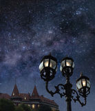 Night in a town. A picture of night street with beautiful starry sky above Royalty Free Stock Images