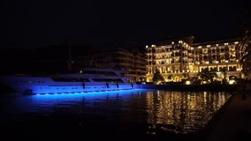 Night town Tivat in Porto Montenegro. Hotel and Sailing boats in the Boka bay, Montenegro, Adriatic, September 2016 in