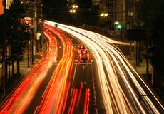 Night traffic. Colourful motion blur abstract on a city road during the night-Sendai, Japan Royalty Free Stock Photos