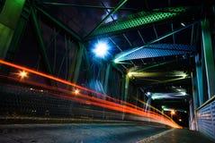 Night traffic. On  a suspension bridge Royalty Free Stock Image