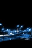 Night traffic. Slow shutter night traffic on a highway with intentional blue cast Royalty Free Stock Image