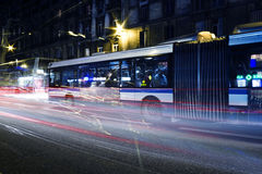 Night Traffic. Long exposure of night traffic, city bus and downtown buildings, street scene Stock Image