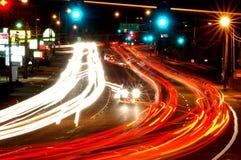 Night Traffic. Traffic on a four lane city street at night Stock Image