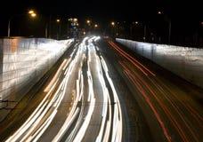 Night traffic. Night jam on the urban highway Royalty Free Stock Photo