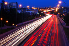 Night traffic. Busy road in a city at night stock photography