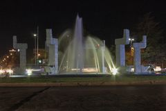 Night traffic around the fountain. royalty free stock photo