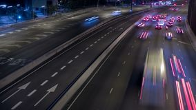 Night Traffic in Barcelona. Trail effect. Scene of traffic at dusk in a main street of entry and exit of Barcelona. Top view.Long exposure. Time Lapse.Trail stock video footage