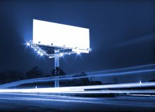Night traffic billboard. Night traffic and white billboard royalty free stock photography