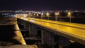 Night traffic on the bridge across the river, Time Lapse, Russia, Krasnoyarsk stock footage