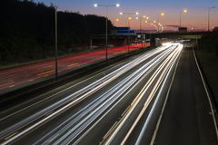 Light trails on the british motorway at night. Night traffic on the British motorway. Red and white light trails created due to long exposure stock photography