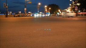 Night traffic, cars on street road on evening night in busy city, urban view. Night traffic, cars on street road on evening night in busy city, urban view stock footage