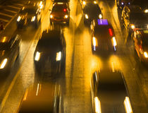 Night traffic in the city. Abstract city traffic. Travel. Royalty Free Stock Photo