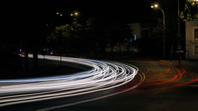 Night traffic in the city and blurry lights from headlights of cars Royalty Free Stock Images
