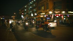 Night traffic on city streets. Dominated by motorbikes and motorcycle taxis