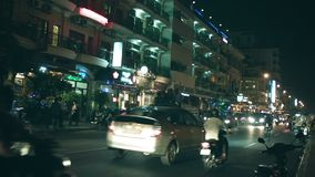 Night traffic on city streets. People go to on motorcycles and backs of the trucks Stock Image