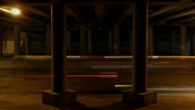 Night traffic in the city in time lapse. The action under bridge. Beautiful action stock video