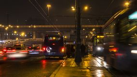 Night traffic and the crowd of people on urban street. Moscow Royalty Free Stock Image