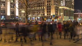 Night traffic and the crowd of people on urban street,. Moscow Royalty Free Stock Photos