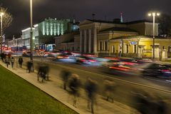 Night traffic and the crowd of people on urban street,. Moscow Stock Image
