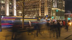Night traffic and the crowd of people on urban street,. Moscow Royalty Free Stock Image