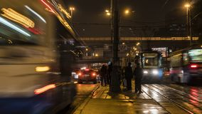 Night traffic and the crowd of people on urban street. Moscow Stock Photos