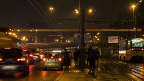 Night traffic and the crowd of people on urban street. Moscow Russia Royalty Free Stock Images