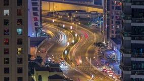 Night traffic between Dubai Marina and JBR aerial timelapse, UAE. Night traffic on curved road between Dubai Marina and JBR aerial timelapse, UAE. Modern stock footage