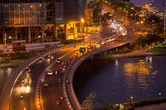 Night traffic at curves of Khanh Hoi Bridge at downtown of Saigon, Vietnam. Ho Chi Minh city is the biggest city in Vietnam Royalty Free Stock Images