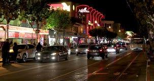 Night traffic at Embarcadero street. SAN FRANCISCO - DECEMBER 26, 2017: Traffic at North Embarcadero street at night - famous tourists` destination stock footage