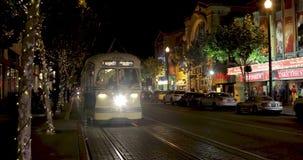 Night traffic at Embarcadero street. SAN FRANCISCO - DECEMBER 26, 2017: Traffic at North Embarcadero street at night - famous tourists` destination stock video