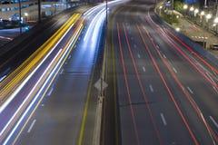 Night traffic headlight streaks Stock Photography