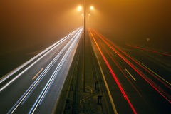 Night traffic on a highway in the fogy night Royalty Free Stock Photo