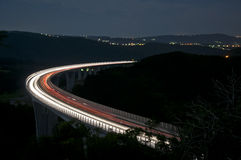 Night traffic on the  highway viaduct Stock Images