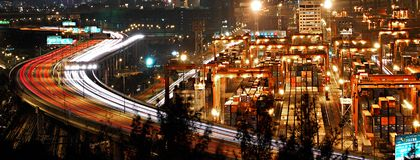 Night Traffic in Hong Kong Cargo Terminal. Cargo terminal and highways of Hong Kong Royalty Free Stock Photos