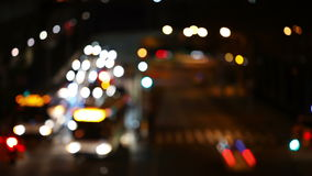 Night Traffic at the Intersection. Blurred. City intersection at night. Many cars, buses. A few pedestrians. Defocusing stock video