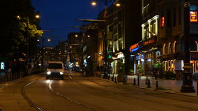 Night traffic. Istanbul. Turkey. Night traffic on the street. Fast moving pedestrians, cars, trams. Istanbul. Turkey 4K stock footage