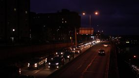 Night Traffic leaving a downtown city area - the outbound lane.  stock video footage