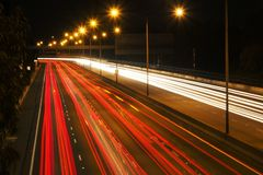 Night Traffic. Light trails on a freeway or motorway at night Royalty Free Stock Photo