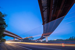 Night traffic with light trails on highway interchange. Night traffic with light trails on highway  interchange Royalty Free Stock Photos