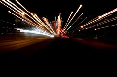 Night traffic lights. Slow shutter night traffic lights on a highway with zoom panning Stock Photo