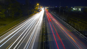 Night traffic lights. From vehicles Royalty Free Stock Images
