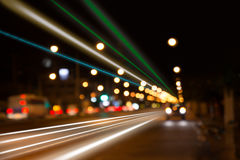 Night traffic lights at intersection. The city lights. Motion blur. Abstract background Royalty Free Stock Photos