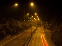 Night traffic lights. Timelapse video of dark highway road with lighten lamps stock video footage