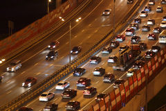 Night traffic with motion cars on Zhivopisny Bridge Royalty Free Stock Photography