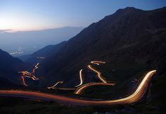 Night traffic on mountain road. Mountain road in night, Romanian Carpathians, Transfagarasan Stock Image