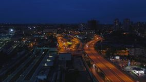 Night traffic movement at the center of Moscow, aerial urban view. Top view of Moscow city skyline at night. Bridge 4K stock video footage