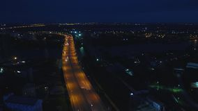 Night traffic movement at the center of Moscow, aerial urban view. Top view of Moscow city skyline at night. 4K stock video