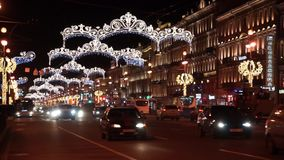Night traffic at Nevsky prospekt illumianted for Christmas stock footage